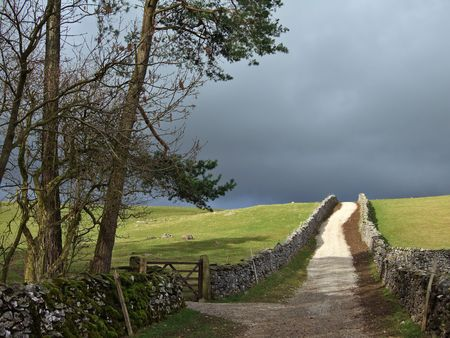 Country lane in the Yorkshire Dales under a stormy sky