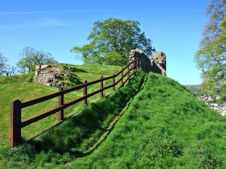 Remains of Kendal castle with wooden fence photo