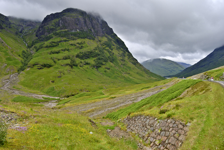 glencoe: One of the Three Sisters of Glencoe. The A82 road can be seen on the right Stock Photo