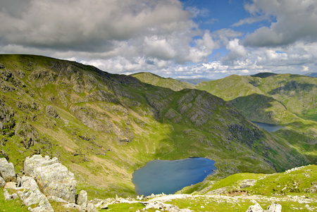 tarn: Low Water & Levers Water seen from the summit of the Old Man of Coniston in the English Lake District Stock Photo