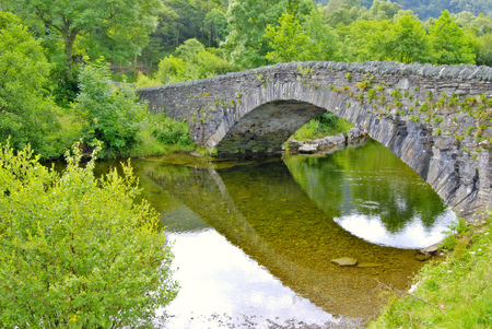 old packhorse bridge: Pack-horse bridge over the river Derwent at Grange in Borrowdale, near Keswick in the English Lake District