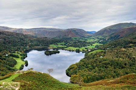 An aerial view of Grasmere in the English Lake district as seen from the slopes of Loughrigg. Grasmere village & Dunmail Raise can be seen in the distance Stock Photo