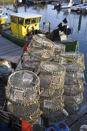 Homar pots i poÅ'owów maÅ'ych Å'odzi w Brighton Marina, East Sussex, Anglia, UK Zdjęcie Seryjne