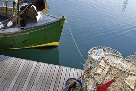 lobster pots: Lobster pots and a small fishing boat at Brighton Marina, East Sussex, England, UK