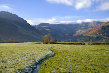 A small stream at the head of Langdale. Crinkle Crags and Pike o Blisco can be seen in the distance Stock Photo