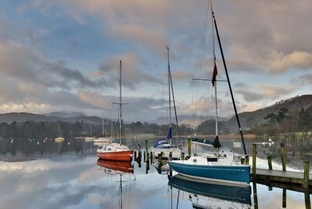 Boats at Waterhead, Ambleside  in early morning light Stock Photo - 2513261