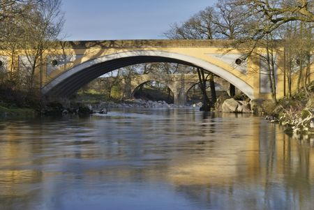 lonsdale: The medieval Devils bridge seen through the modern road gridge on the river Lune near Kirkby Lonsdale, Cumbria, UK