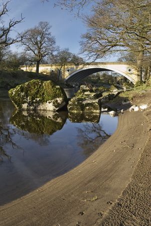 lonsdale: The sandy bank of the river Lune with the modern road bridge at Kirkby Lonsdale, Cumbria, England