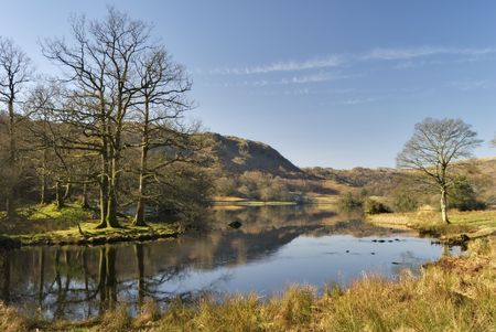 lake district: A view of Rydal Water in the English Lake District in early morning sunlight Stock Photo