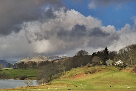 lake district england: Stormy skies over the Langdale Pike in the English lake District