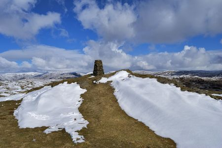 brunt: The snow streaked summit and trig point of Brunt Knott, a hill in the English lake District