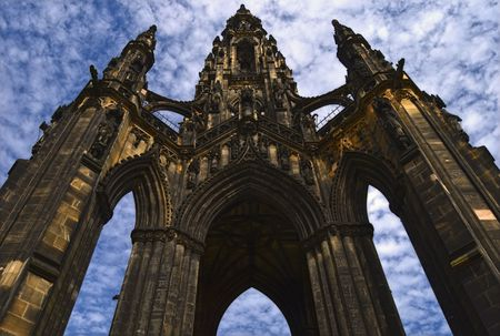 A perspective view of the Scott Memorial in Edinburgh with a background of clouds photo