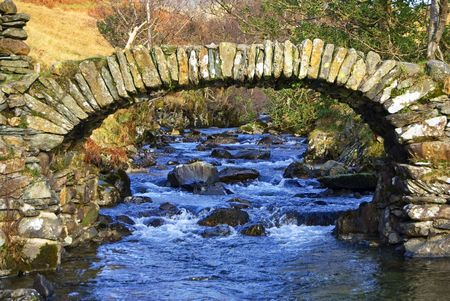 old packhorse bridge: High Sweden bridge in near Ambleside in the English Lake District. A fine example of an old packhorse bridge