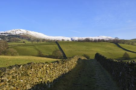 Typical Northern English Famland near Staveley, Cumbria with snowy hills in the background Stock Photo - 4019416