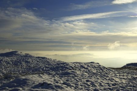 brunt: The summit of Brunt Knott in the English Lake District with fresh snow and a bright hazy horizon