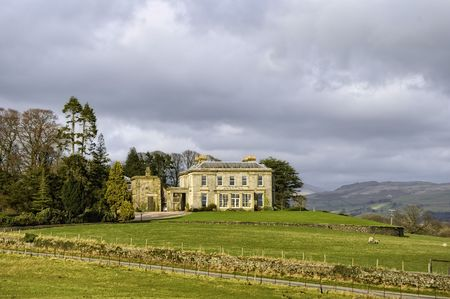 stately home: Scenic view of luxurious manor house on countryside estate, England Stock Photo