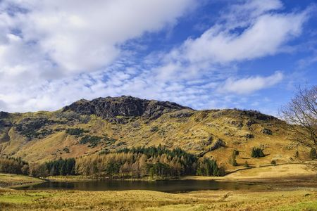 remoteness: Scenic view of mountainous landscape of Lake District with Blea Tarn lake in foreground, Cumbria, England