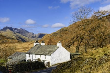 tarn: Scenic view of mountainous landscape of Lake District National park with Blea Tarn house in foreground, Cumbria, England