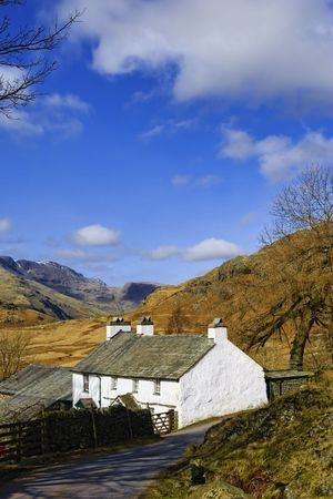 Scenic view of mountainous landscape of Lake District National park with Blea Tarn house in foreground, Cumbria, England Stock Photo - 4620836