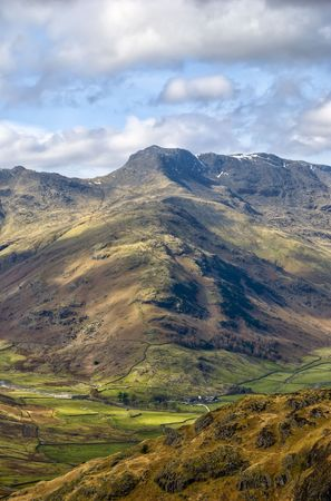 fells: Scenic view of Band ridge leading to summit of Bow Fell mountain, Southern Fells, Lake District National Park, Cumbria, England
