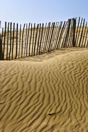 A sandy beach and dune fence.