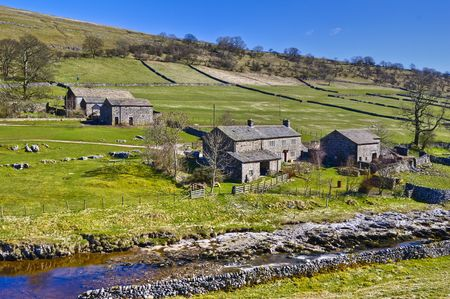 Scenic view of stone farm buildings in countryside with stream in foreground, Yockenthwaite, Wharfdale Valley, Yorkshire, England. Stock Photo - 4868432