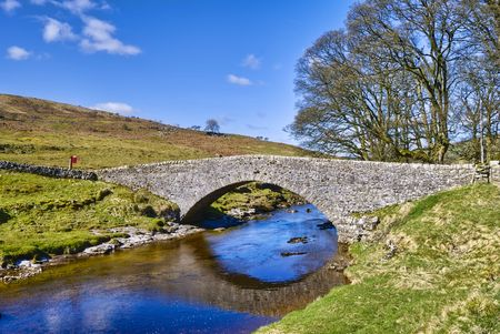 old packhorse bridge: Scenic view of stone packhorse bridge over river Wharfe,  Stock Photo