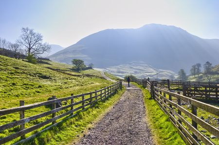 Landscape view of a woman walking on a path from Hartsop to Hayeswater in the English Lake District National Park, located in Cumbria, England, United Kingdom. Stock Photo - 4930817