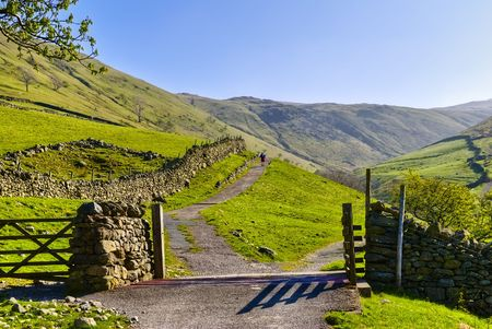 Landscape view of a gate and cattle grid on the path from Hartsop to Hayeswater in the English Lake District National Park in Cumbria, England, United Kingdom. Stock Photo