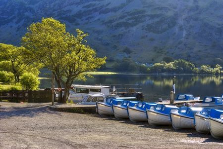 Boats on the shore of Ullswater in the English Lake District National Park, Cumbria, England (UK).