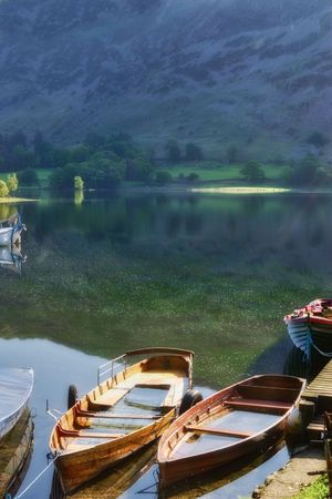 Close up of wooden rowing boats on Lake Ullswater, Lake District National Park, Cumbria, England. Stock Photo