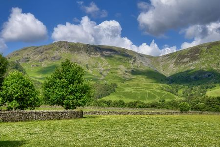 borrowdale: Scenic view of Borrowdale Valley with mountains and cloudscape in background, Lake District National Park, Cumbria, England.