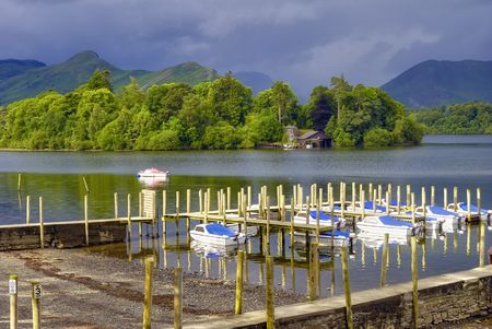Scenic view of boats moored in small harbour on Derwent Water, Lake District National Park, Cumbria, England. photo