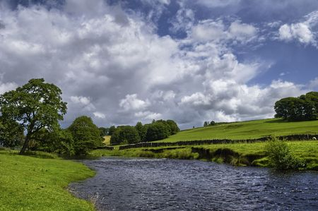 lancashire: Scenic view of Hodder river in countryside under cloudscape, Forest of Bowland, Lancashire, England. Stock Photo
