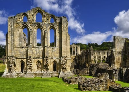 Scenic view of ruins of Rievaulx Abbey under cloudscape, North Yorkshire Moors, National Park, England.