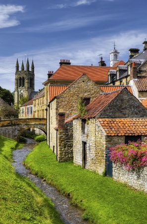 Scenic view of stream running past Helmsley town with church in background, Ryedale, North Yorkshire, England. Stock Photo - 5546719