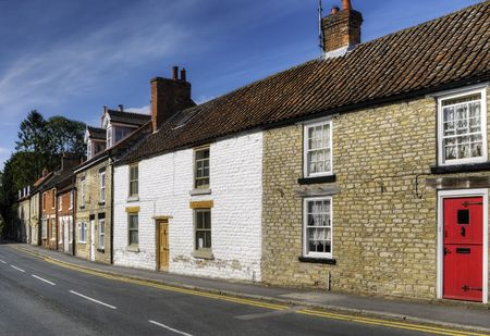 housed: Row of terraced housed in Thornton-le-Dale village, Ryedale, North Yorkshire, England. Stock Photo