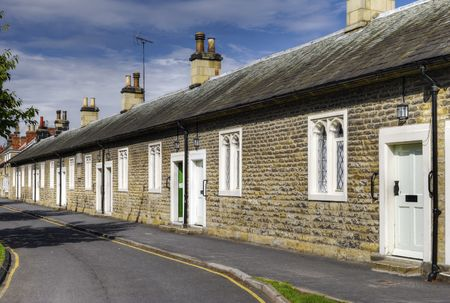 Row of 17th century historic almshouses in village of Thornton-le-Dale, North Yorkshire, England. Stock Photo - 5546722