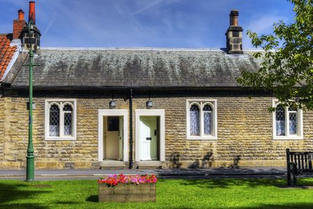 sheltered: Row of 17th century historic almshouses in village of Thornton-le-Dale, North Yorkshire, England.