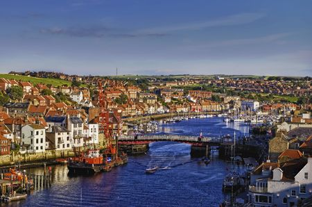 Aerial view of Whitby town and harbor looking inland, North Yorkshire, England.