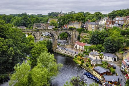 Aerial view of Knaresborough town with stone viaduct over river Nidd, North Yorkshire, England