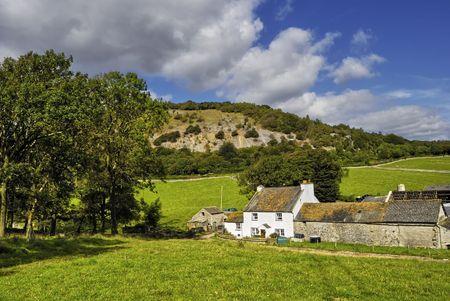 pastureland: A scenic country farmhouse and fields near Arnside, England. Stock Photo
