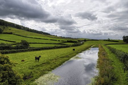 Scenic view of Lancaster Canal under dark cloudscape, Farelton, Cumbria, England. Stock Photo - 5991800