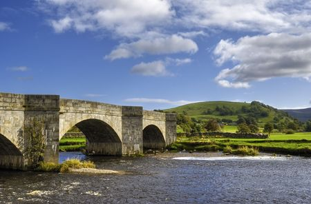 old packhorse bridge: Scenic view of old packhorse bridge over river Wharfe, Yorkshire Dales National Park, England.