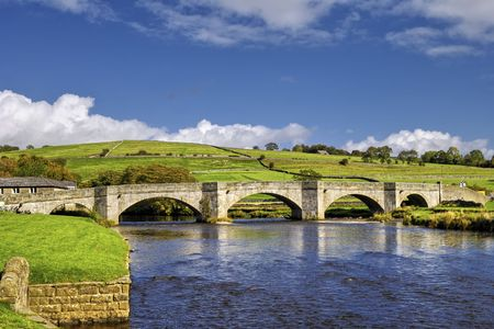 old packhorse bridge: Scenic view of packhorse bridge over river Wharfe, Yorkshire Dales National Park, England. Stock Photo