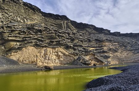 golfo: Scenic view of Green Lagoon with eroded volcanic crater background, El Golfo, Lanzarote, Canary Islands, Spain.