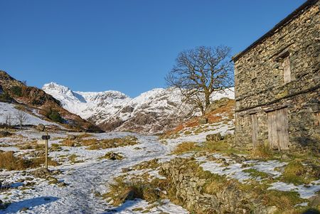 Side of traditional stone barn building in snow covered countryside, Langdale, Lake District National Park, Cumbria, England. Stock Photo - 6702695