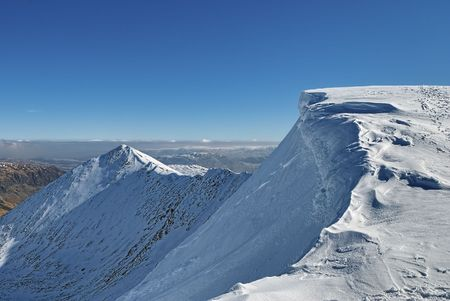 Scenic view of snow covered Helvellyn mountain summit in Winter, Lake District National Park, Cumbria, England. Stock Photo - 6737128