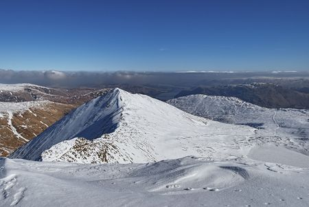 Scenic view of snow covered Catstye Cam fell in Winter viewed from Helvellyn mountains, Lake District National Park, Cumbria, England. Stock Photo - 6737127
