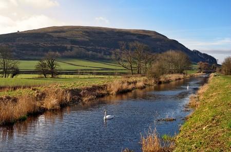 receding: Scenic view of Lancaster Canal receding through countryside, Farleton, Cumbria, England.